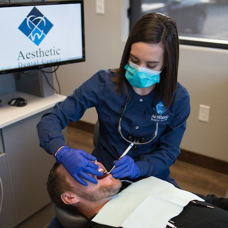 Our assistant caring for one of our patients before surgery for their dental implants in Bismarck, ND