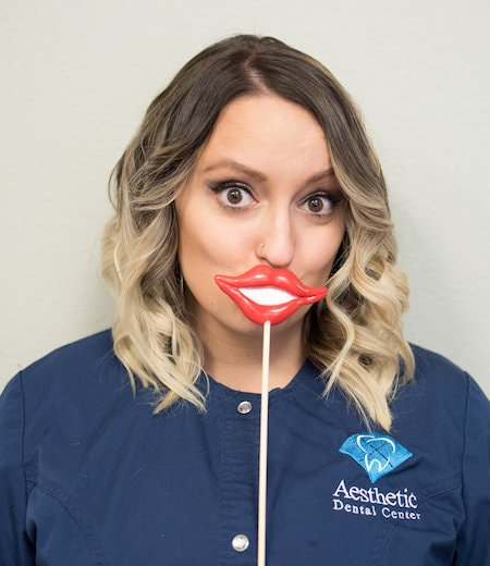 Lori H. is a team member who is hiding behind comedy lips