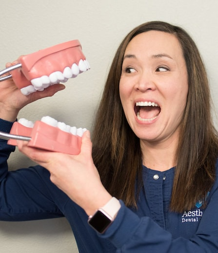 Lori M. is on our team and has fun with our tooth props