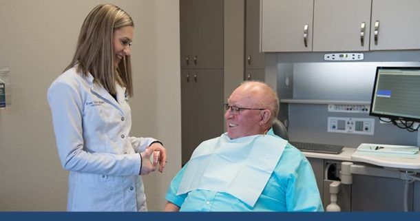 Dr. Krysta Sellers talking to a patient about being a dental implants candidate