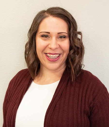 Courtney is on our team as a office manager and is seen smiling here