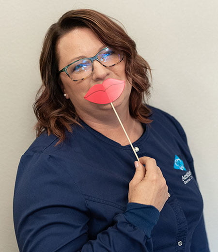 Sondy is on our team and has fun with our smile props