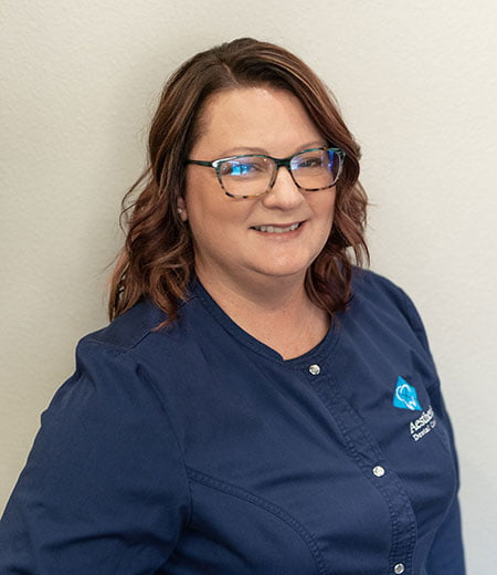 Sondy is on our team as a dental assistant and is seen smiling here
